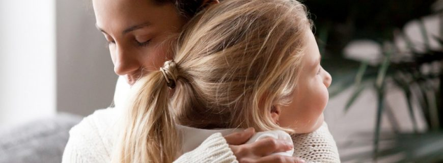 bigstock_Loving_Mother_Hugging_Cute_Lit_235958218